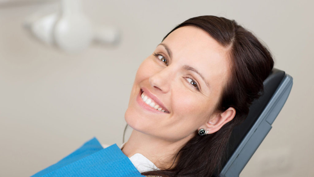 woman at dentist about to get sedation