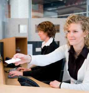 receptionist with card