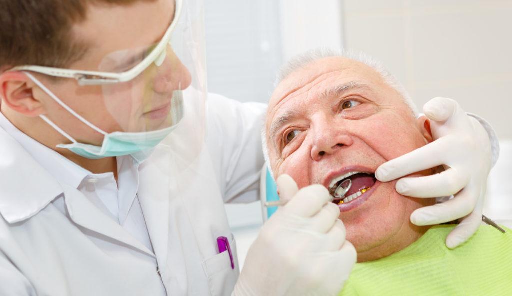 man getting gum examed