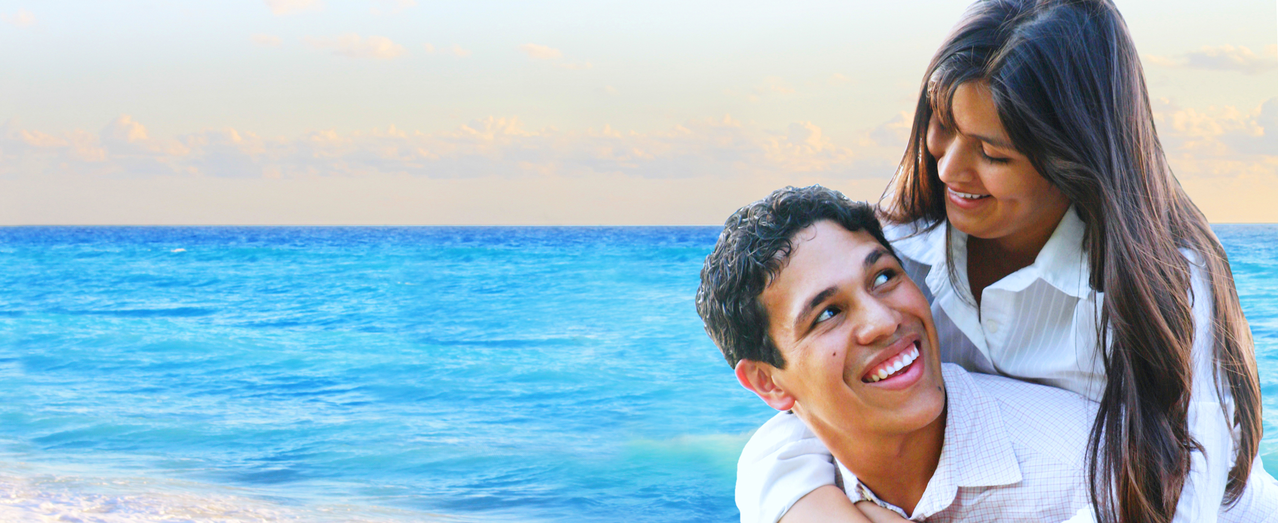 smiling couple by the ocean