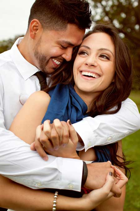 young couple laughing and smiling